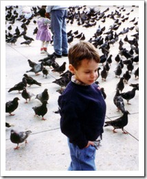 My son Andrew reveling in Piazza San Marco in 1995