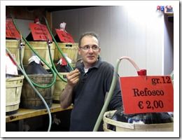 Umberto fills bottles with sfuso wine for his clients