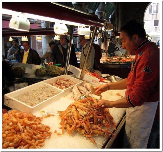 Rialto Fish Monger prepping Scampi