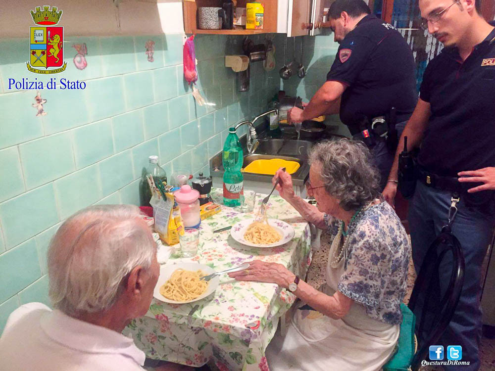 The Rome Police coming to the aid of an older couple in the August heat, whipping up a plate of pasta.