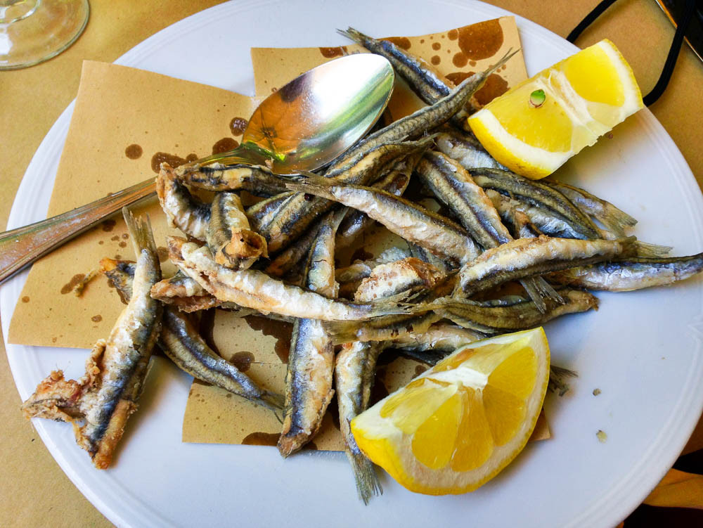 Fried tiny anchovies that were swimming in the Med just last night. It doesn't get any more local than this.