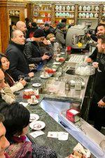 Grabbing a coffee in a bustling scene at Tazza d'Oro