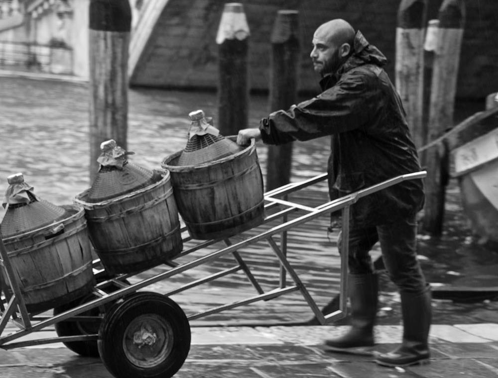 Wine distribution the old fashioned way in Venice. Yes, they still do this today.